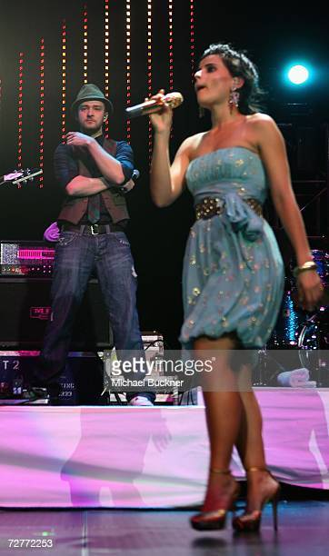 Singer Justin Timberlake and singer Nelly Furtado perform at KIIS FM's Jingle Ball 2006 at the Honda Center on December 7 2006 in Anaheim California