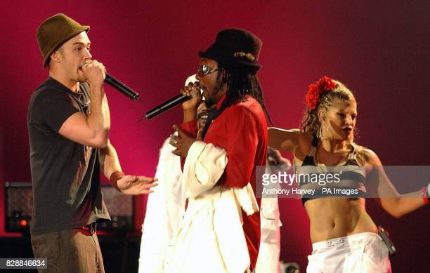 Singer Justin Timberlake and The Black Eyed Peas perform live on stage during the MTV Europe Music Awards 2003 at Western Harbour in Leith Edinburgh