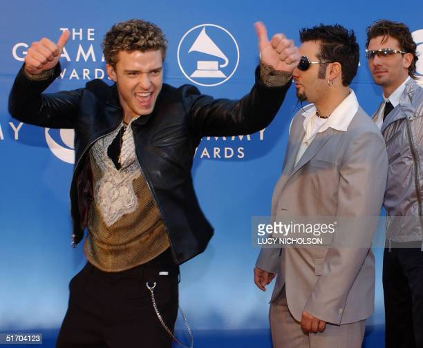 US singer Justin Timberlake Chris Kirkpatrick and JC Chasez of the group NSync arrive at the 44th Annual Grammy Awards in Los Angeles CA 27 February...