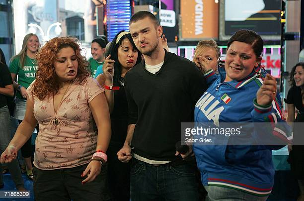Singer Justin Timberlake dances with audience members onstage during MTV's Total Request Live at the MTV Times Square Studios on September 12 2006 in...