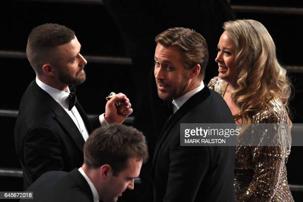 "Singer Justin Timberlake shakes hands with nominee for Best Actor in ""La La Land"" Ryan Gosling as he arrives at the 89th Oscars on February 26, 2017..."