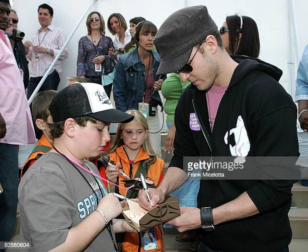 Singer Justin Timberlake sign autographs at the 18th Annual Kids Choice Awards at UCLA's Pauley Pavillion on April 2 2005 in Westwood California