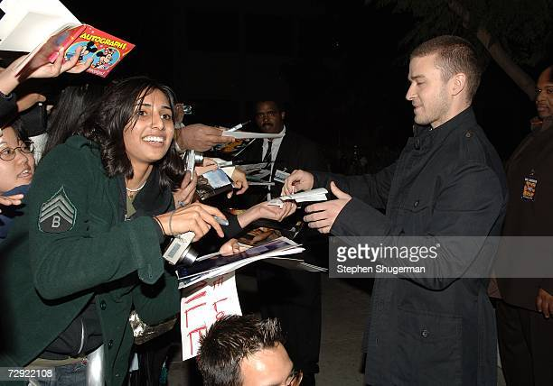 Singer Justin Timberlake signs autographs at the premiere of Universal Pictures' Alpha Dog at the Cinerama Dome on January 3 2007 in Hollywood...