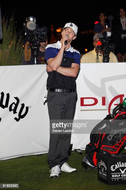 Singer Justin Timberlake speaks during his attempt to win a one million charitable donation to Shriners Hospitals for Children by hitting a holeinone...