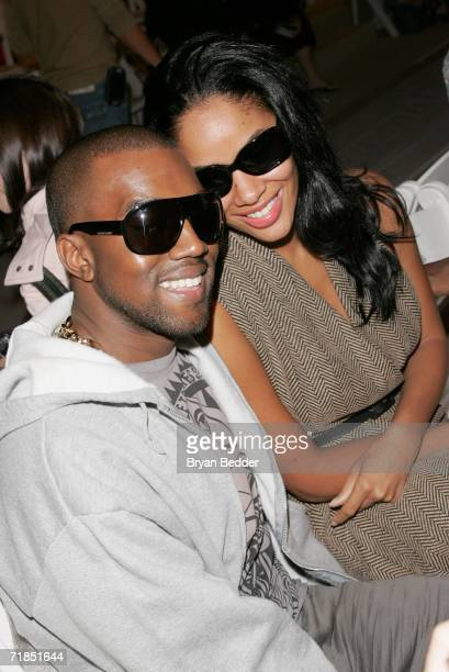 Singer Kanye West and his fiance Alexis pose in the front row at the Luca Luca Spring 2007 fashion show during Olympus Fashion Week at the Promenade...