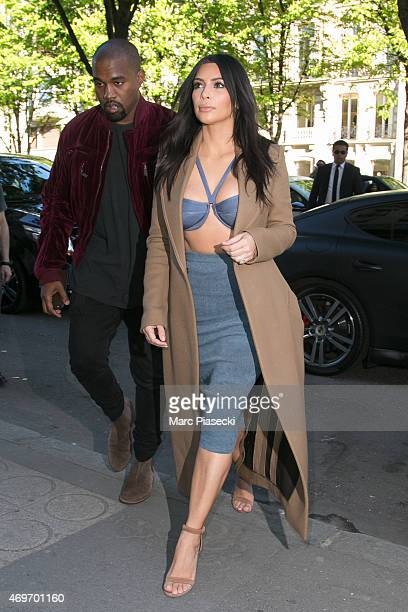 Singer Kanye West and his wife Kim Kardashian West are seen arriving at the 'Montaigne Market' store on April 14 2015 in Paris France