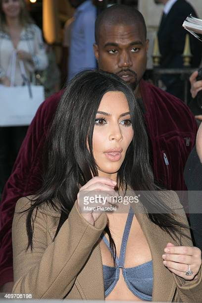 Singer Kanye West and his wife Kim Kardashian West are seen leaving the 'Montaigne Market' store on April 14 2015 in Paris France