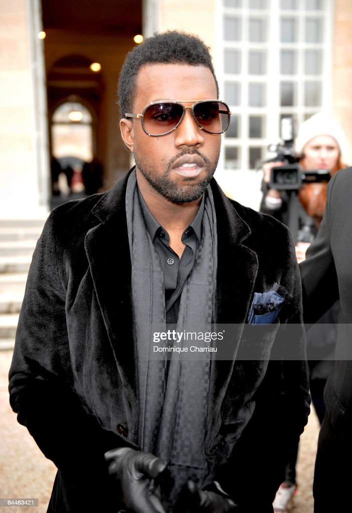 US singer Kanye West attends the Christian Dior fashion show during Paris Fashion Week Haute Couture Spring/Summer 2009 at Musee Rodin on January 26, 2009 in Paris, France.