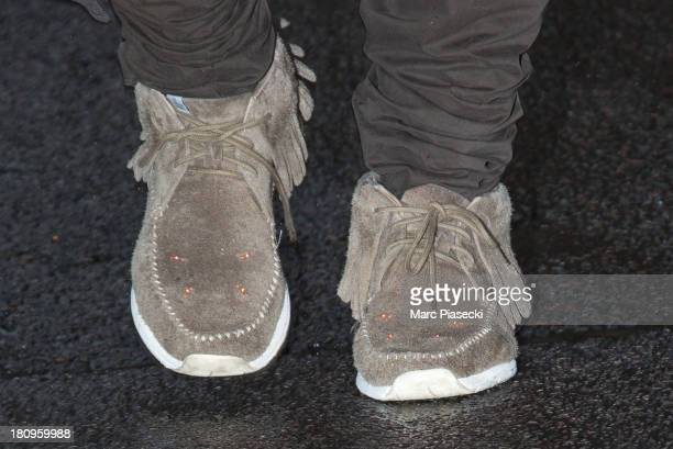 Singer Kanye West is seen leaving the 'APC' office on September 18 2013 in Paris France