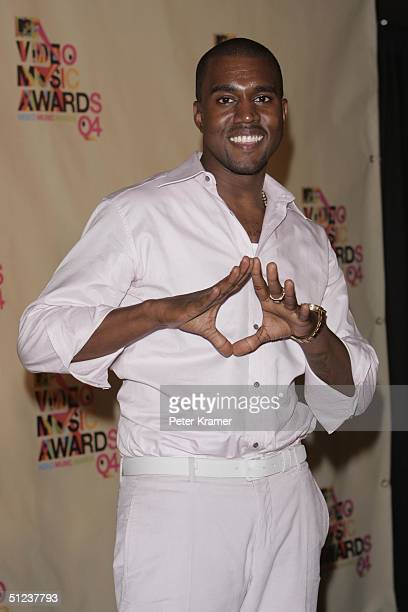 Singer Kanye West poses in the press room at the 2004 MTV Video Music Awards on August 29 2004 at the American Airlines Arena in Miami Florida