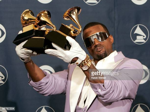 Singer Kanye West poses with his Best Rap Song Best Rap Solo Performance and Best Rap Album awards in the press room at the 48th Annual Grammy Awards...