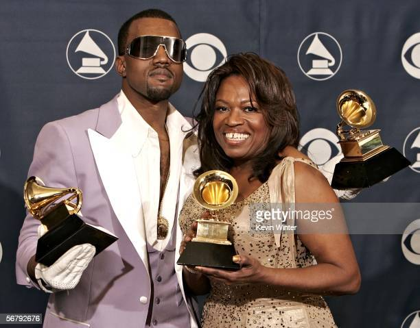 Singer Kanye West with his awards for Best Rap Song Best Rap Solo Performance and Best Rap Album with his mother Donda West pose in the press room at...