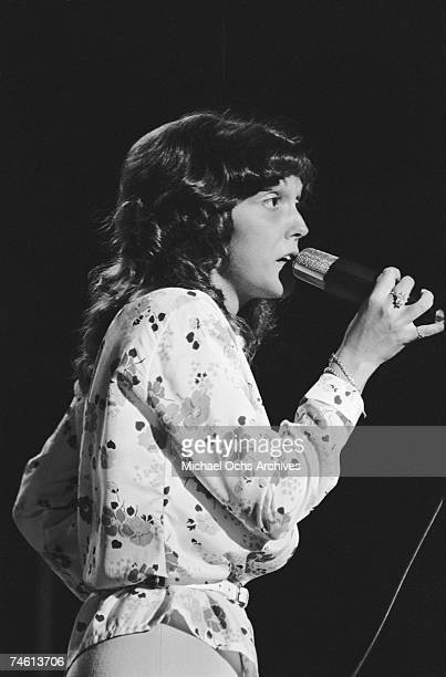 Singer Karen Carpenter of the brother/sister group The Carpenters performs on stage during a mid1970s concert in Los Angeles California
