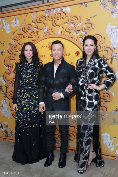 Singer Karen Mok actor Donnie Yen and his wife Cecilia Wang attend the 12th anniversary banquet of fashion magazine Prestige on October 20 2017 in...
