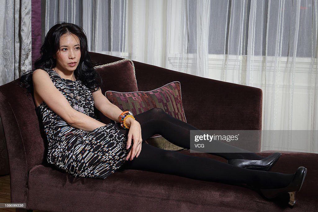 Singer Karen Mok attends a press conference to promote her new album 'Somewhere I Belong' on January 16, 2013 in Shanghai, China.
