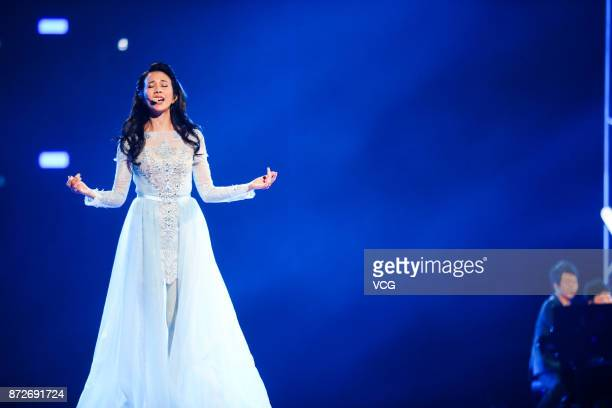 Singer Karen Mok performs on the stage during 2017 Alibaba Singles' Day Global Shopping Festival gala at MercedesBenz Arena on November 10 2017 in...