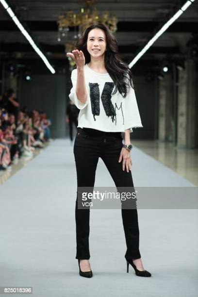 Singer Karen Mok walks the runway at Replay fashion show on July 31 2017 in Shanghai China