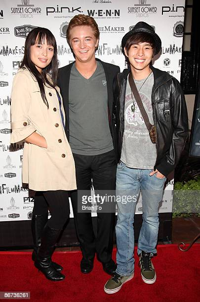 Singer Kate Earl actor Michael Welch and actor Justin Chon arrive at Lost Dream Los Angeles Premiere at the Stanley Kramer Theater on May 7 2009 in...