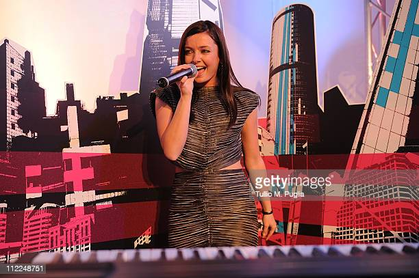 Singer Katerine Avgoustakis performs during Benedict Radcliffe wireframe design installation inspired by Range Rover Evoque at the Opificio 31 during...
