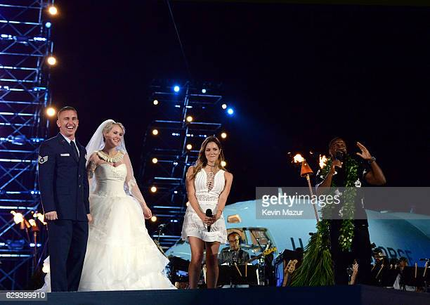 Singer Katharine McPhee and actor Kevin Hart oversees the wedding ceremony of Air Force Staff Sergeant Kory Hitchens and Marine Corps Sergeant Emily...