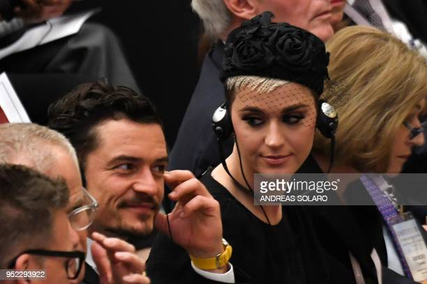 US singer Katheryn Elizabeth Hudson known professionally as Katy Perry looks towards British actor Orlando Bloom as an unseen Pope Francis delivers a...