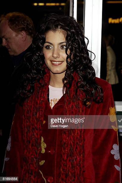 Singer Katie Melua arrives at the premiere screening of the new fourdisc DVD featuring 10 hours of footage from the historic charity concert Live Aid...