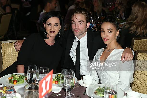 Singer Katy Perry actor Robert Pattinson and FKA twigs attend the 8th Annual GO Campaign Gala at Montage Beverly Hills on November 12 2015 in Beverly...
