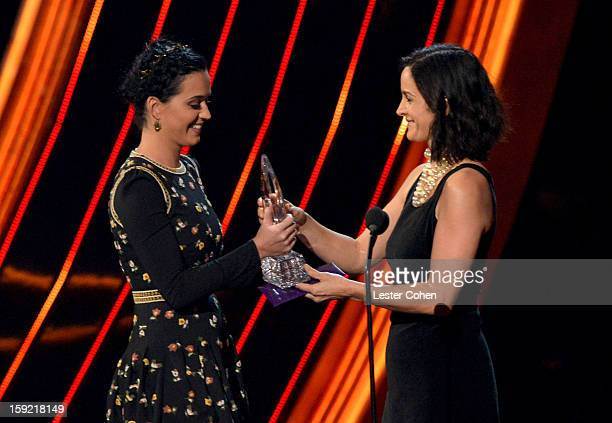 Singer Katy Perry and actress CarrieAnne Moss onstage during the 2013 People's Choice Awards at Nokia Theatre LA Live on January 9 2013 in Los...