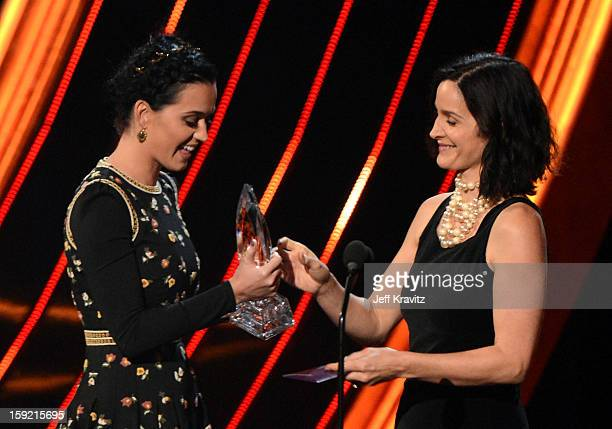 Singer Katy Perry and presenter Carrie Anne Moss onstage during the 2013 People's Choice Awards at Nokia Theatre LA Live on January 9 2013 in Los...