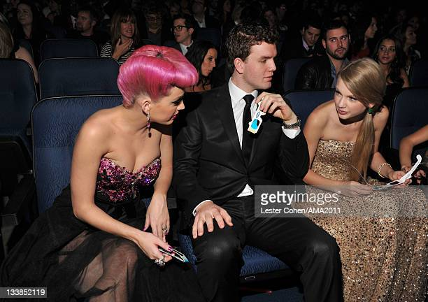 Singer Katy Perry Austin Swift and singer Taylor Swift at the 2011 American Music Awards held at Nokia Theatre LA LIVE on November 20 2011 in Los...