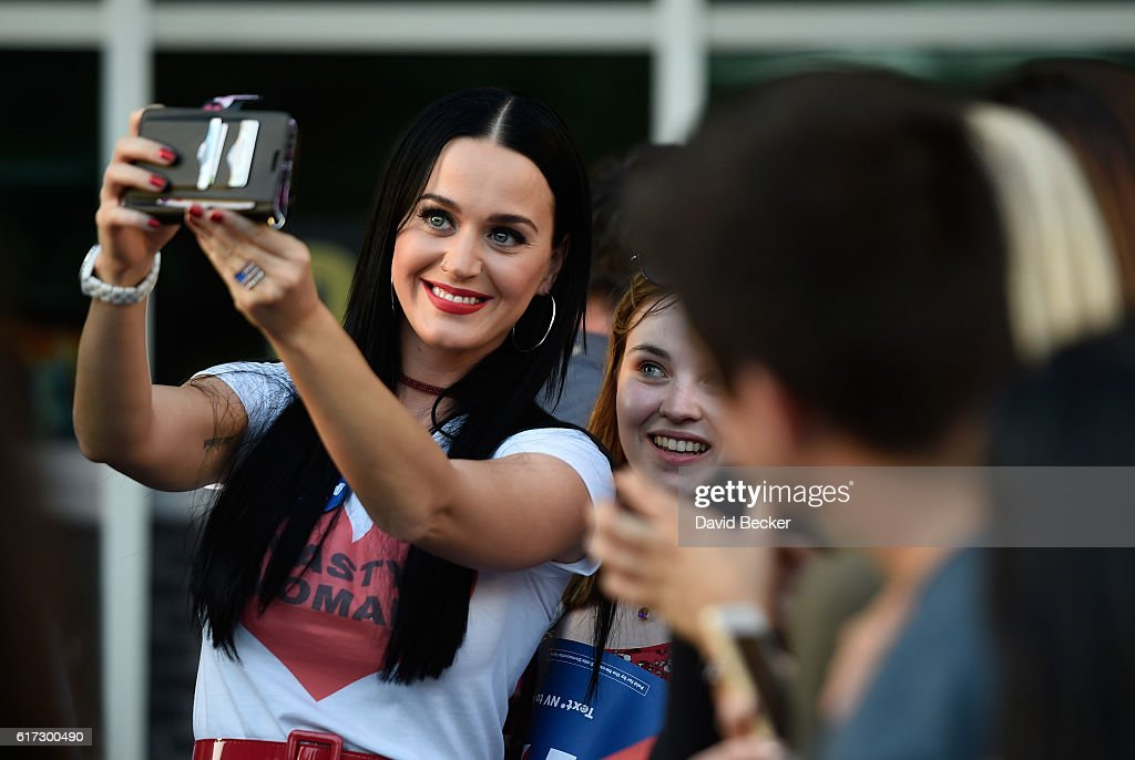 Singer Katy Perry greets people after speaking at a get out