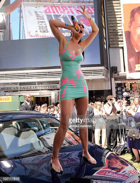 Singer Katy Perry performs atop the new 2011 Volkswagen Jetta Compact Sedan at the world premiere of Volkswagen's new Jetta compact sedan at Times...