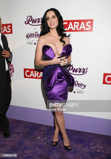 Singer Katy Perry poses for photographers during the launch of her new fragrance Purr at Distrito Capital on February 5 2011 in Mexico City Mexico