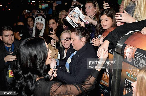 Singer Katy Perry poses with a fan at Comedy Central's night of too many stars America comes together for autism programs at The Beacon Theatre on...