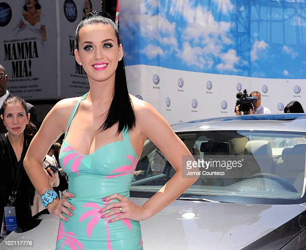 Singer Katy Perry poses with new 2011 Volkswagen Jetta Compact Sedan at the world premiere of Volkswagen's new Jetta compact sedan at Times Square on...