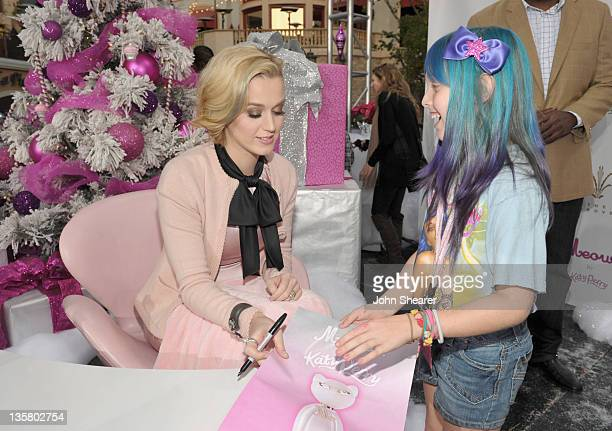 Singer Katy Perry signs autographs with fans at Katy Perry launches MEOW by Katy Perry available exclusively at Nordstrom held at The Grove on...