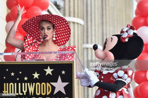 Singer Katy Perry speaks on stage next to Minnie Mouse during a star ceremony in celebration of the 90th anniversary of Disney's Minnie Mouse at the...
