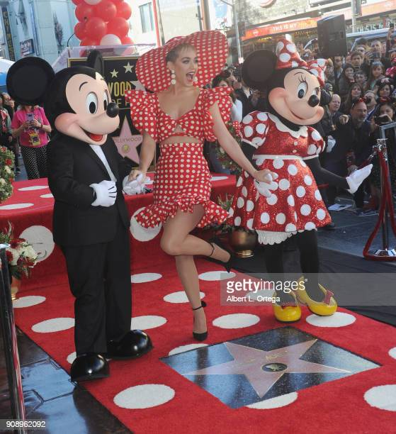 Singer Katy Perry with Mickey and Minnie Mouse at Disney's Minnie Mouse 90th Anniversary Celebration Star ceremony On The Hollywood Walk Of Fame on...