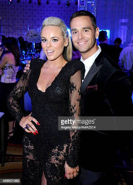 Singer Katy Tiz and TV personality Karl Schmid attend the official 2014 American Music Awards after party at the at Nokia Theatre LA Live on November...
