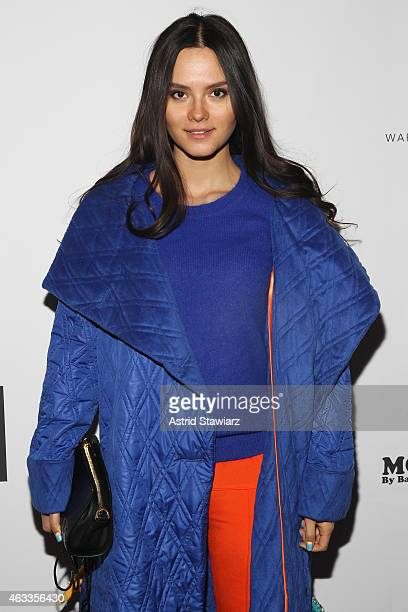 Singer Katya Lee poses backstage at the Mongol fashion show during Mercedes-Benz Fashion Week Fall 2015 at The Theatre at Lincoln Center on February...