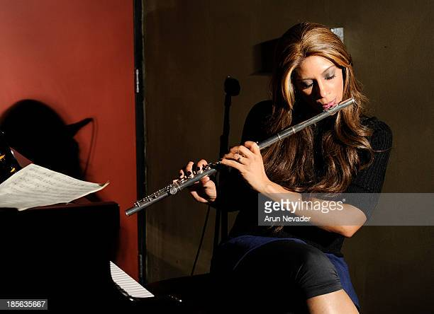 Singer Kaylene Peoples plays flute during her My Man CD recording session featuring pianist Bobby Lyle on October 22 2013 at the Mouse House Studio...