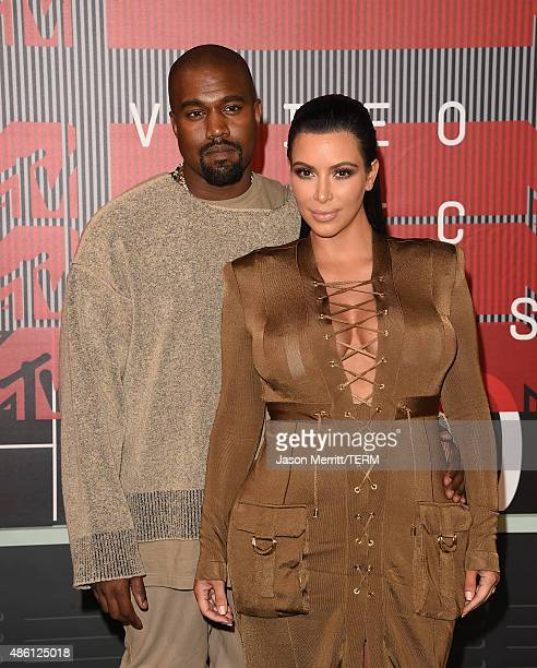 Singer Kayne West and TV personality Kim Kardashian attend the 2015 MTV Video Music Awards at Microsoft Theater on August 30 2015 in Los Angeles...