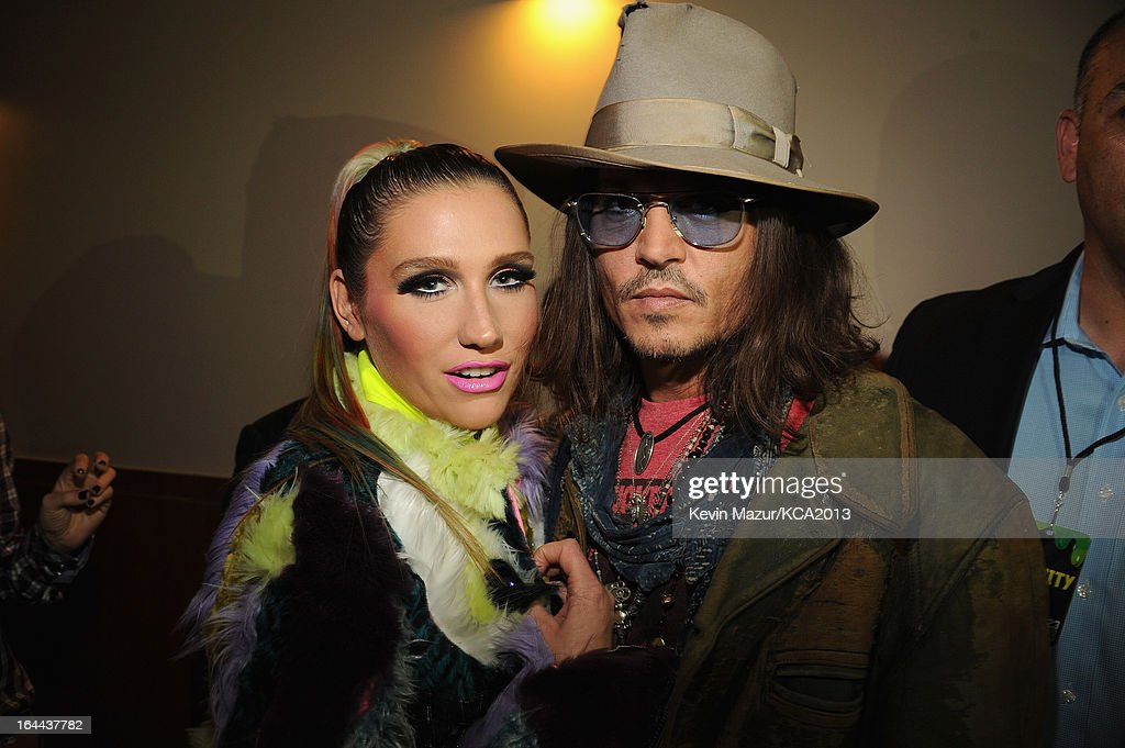 Singer Ke$ha (L) and actor Johnny Depp attend Nickelodeon's 26th Annual Kids' Choice Awards at USC Galen Center on March 23, 2013 in Los Angeles, California.