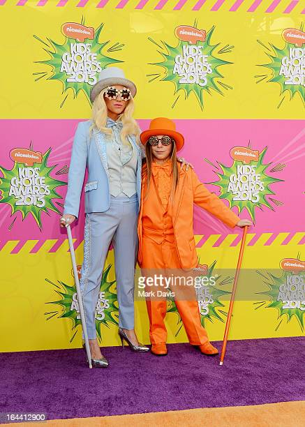 Singer Ke$ha and Louie Sebert arrive at Nickelodeon's 26th Annual Kids' Choice Awards at USC Galen Center on March 23 2013 in Los Angeles California