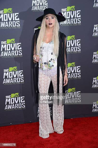 Singer Ke$ha arrives at the 2013 MTV Movie Awards at Sony Pictures Studios on April 14 2013 in Culver City California
