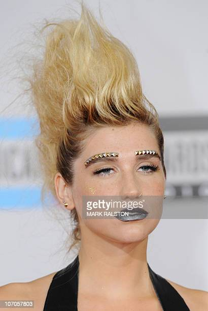 Singer Ke$ha arrives on the red carpet for the 2010 American Music Awards at the Nokia Theatre in Los Angeles on November 21 2010 AFP PHOTO/Mark...