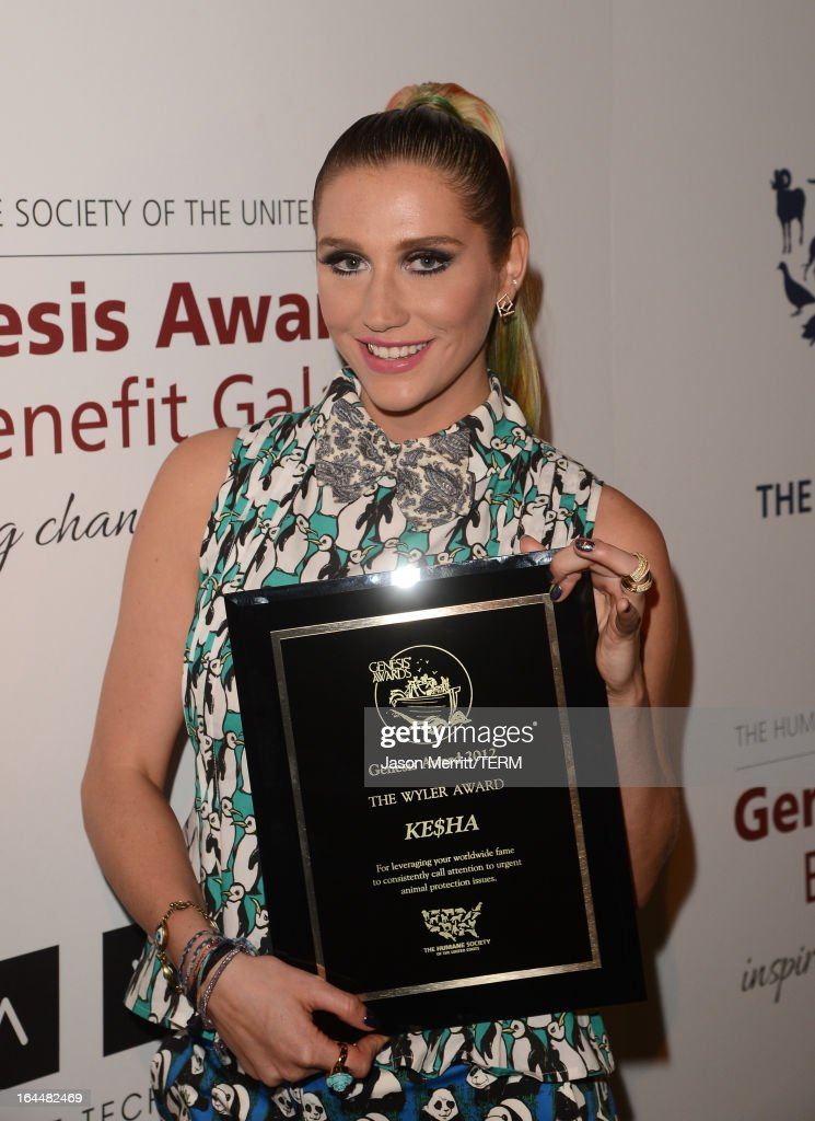 Singer Ke$ha poses backstage after receiving The Wyler Award at The Humane Society of the United States 2013 Genesis Awards Benefit Gala at The Beverly Hilton Hotel on March 23, 2013 in Los Angeles, California.