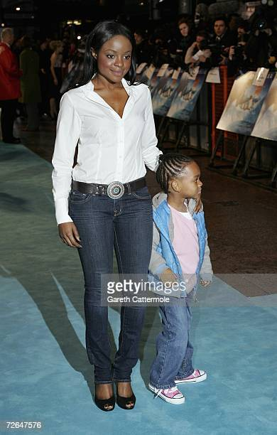 Singer Keisha Buchanan of Sugababes and unidentified guest attend the UK premiere of the movie 'Happy Feet' held at the Empire Leicester Square on...
