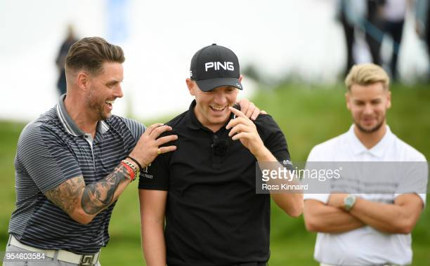 Singer Keith Duffy jokes with Matt Wallace of England on the 6th green during the ProAm tournament ahead of the GolfSixes at The Centurion Club on...