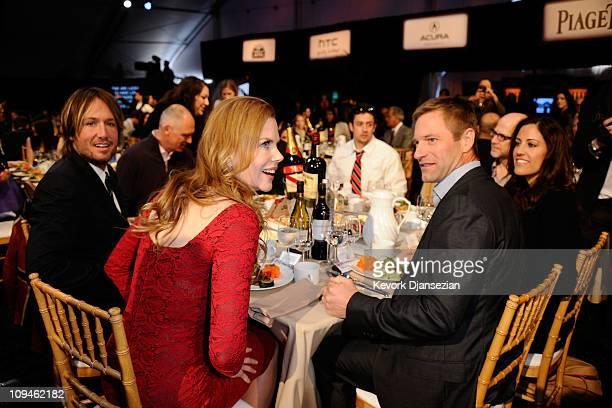 Singer Keith Urban actors Nicole Kidman and Aaron Eckhardt during the 2011 Film Independent Spirit Awards at Santa Monica Beach on February 26 2011...
